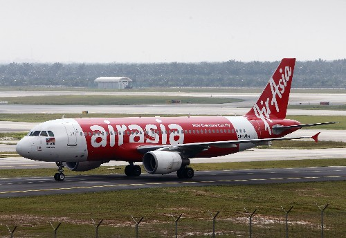 AirAsia Group's quarterly operating profit halves as fuel costs bite