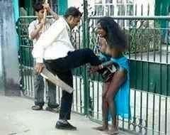 A Saudi Arabien man, beating a Kenia girl