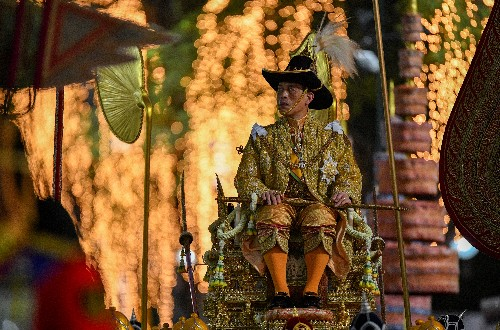Thai king completes coronation year with barge procession through old Bangkok