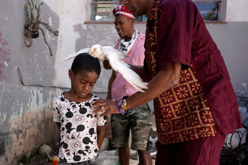 With bird sacrifices and chants, Cuba's Santeria seek protection from coronavirus