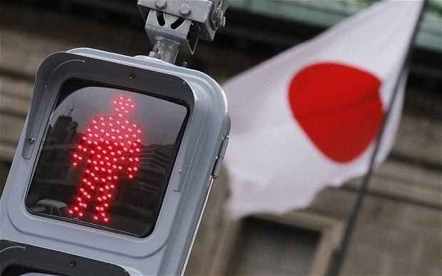 Japan's economy shrinks again as 'Abenomics' stimulus called into question