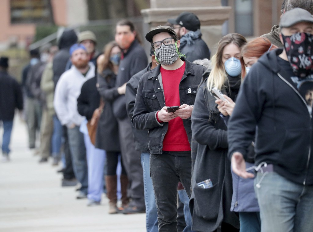 Pandemic politics: Wisconsin voting underway despite virus