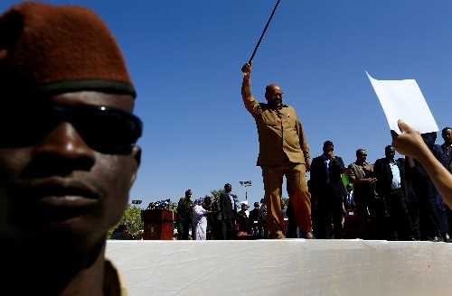 Day into emergency rule, Sudan's Bashir names VP and prime minister