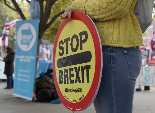The Latest: EU lawmaker backs 3-month Brexit extension