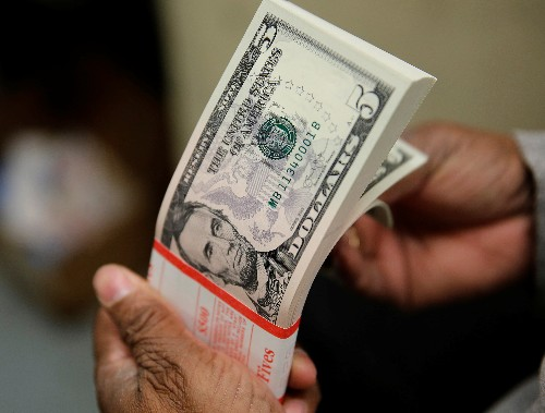 Dollar gains on hopes for trade, Fed on hold