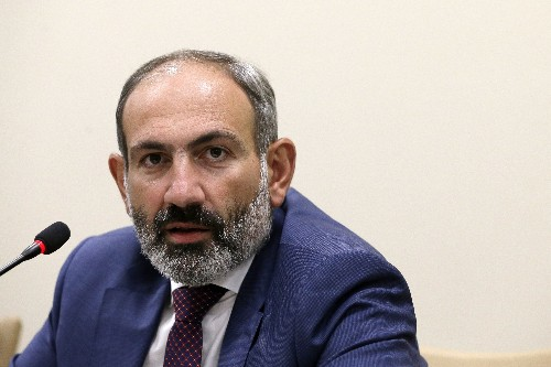 Armenian premier steps down, maneuvering for early election