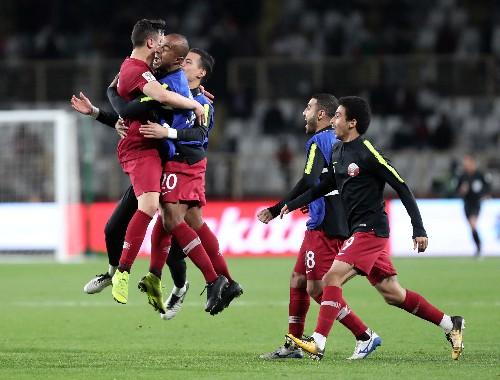 Soccer: Stunning free kick sends Qatar into Asian Cup quarter-finals