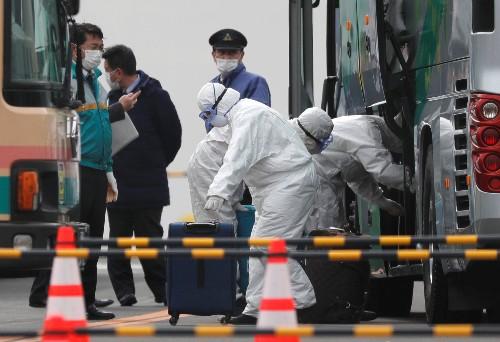 Two passengers from coronavirus-hit cruise ship in Japan die, authorities defend quarantine