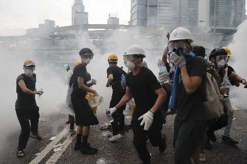 Hong Kong delays bill debate as protest crowds amass at HQ