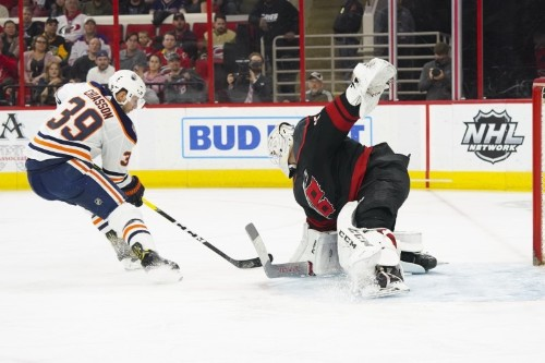 NHL roundup: Devils score final 4 goals, top Wild in OT