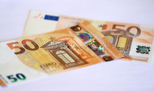 Euro falls on weak German business morale, stocks slip