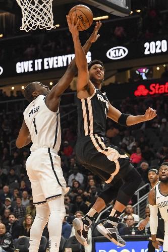 Nets use balanced scoring to down Hawks