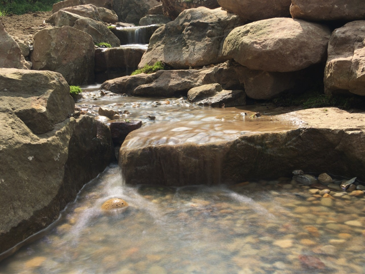 Part of a 50' Pondless Waterfall in Western Pennsylvania, designed and installed by Aquatic Edge.