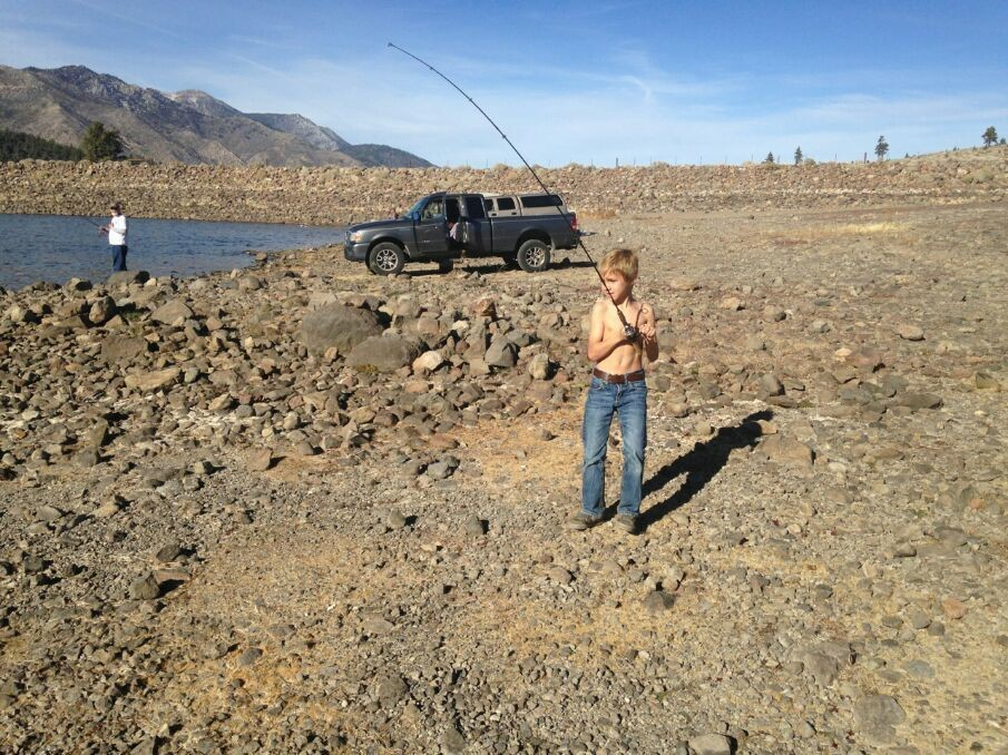 Fishing and tanning at the same time...