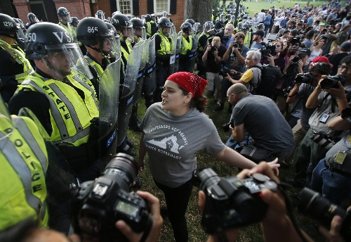Tense confrontation amid peaceful vigils in Charlottesville