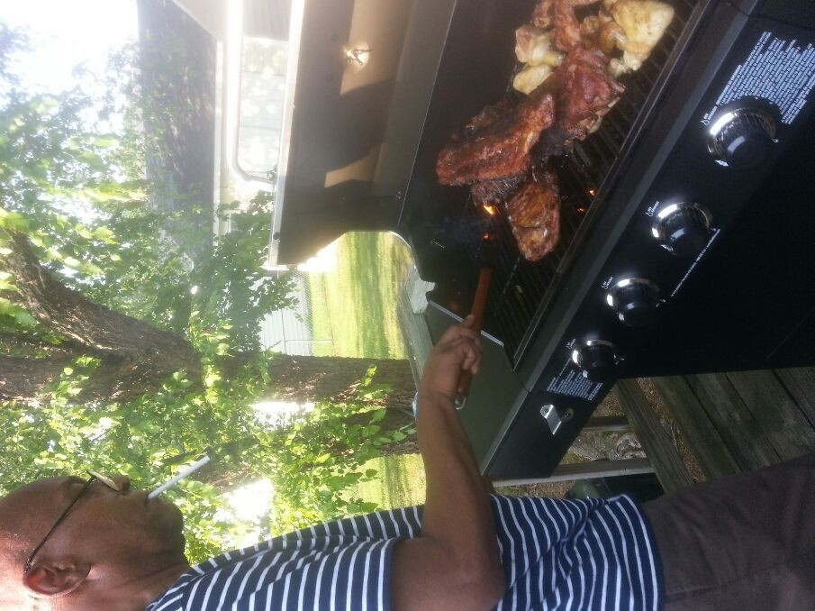 Daddy really is enjoying that grill :-)