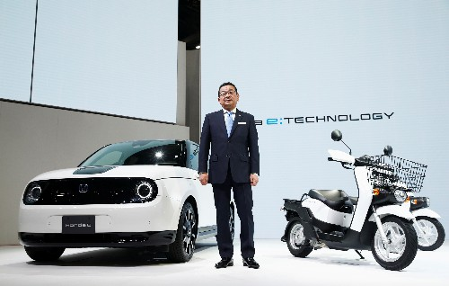 To go big on EVs, Japanese car makers think super-small