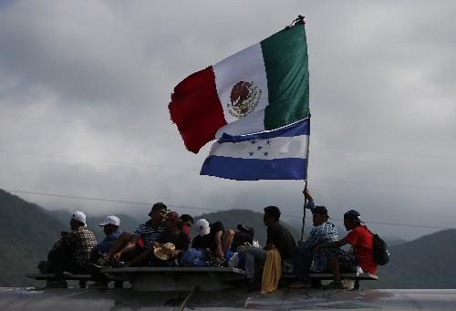 Mexican agents nibble at edges of migrant caravans