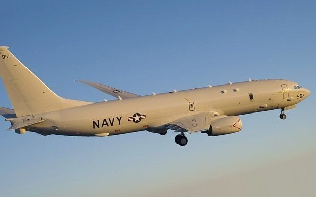 Chinese navy warns US spy plane in contested South China Sea