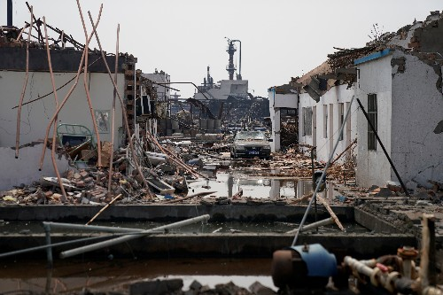 China rescuers pull survivor from blast rubble as death toll rises