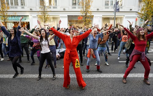 Dancing crowds protest in Madrid while climate leaders meet