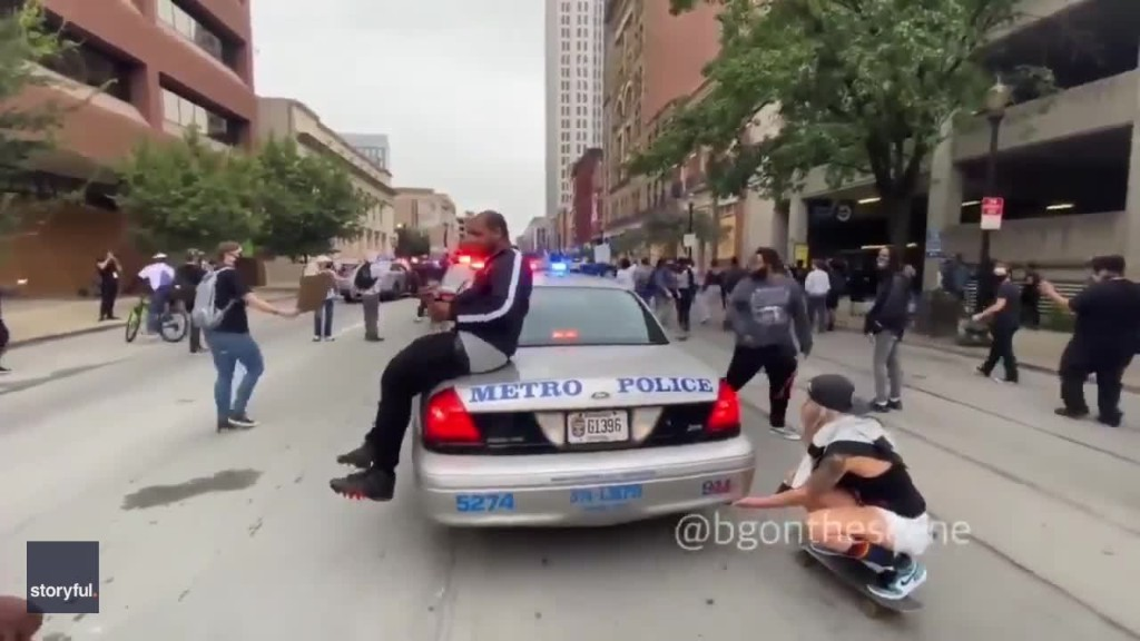 Demonstrators Seen Atop Louisville Police Cruisers During Breonna Taylor Protest