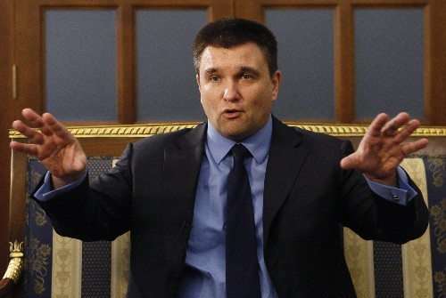 AP Interview: Ukraine minister claims Russia on its knees