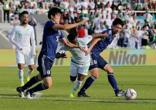 Soccer: Japan edge profligate Saudis to reach Asian Cup quarter-finals