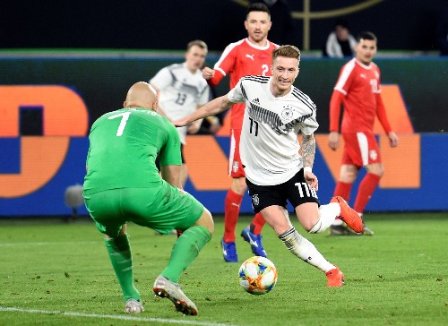 Soccer: New-look Germany make promising start with Serbia draw