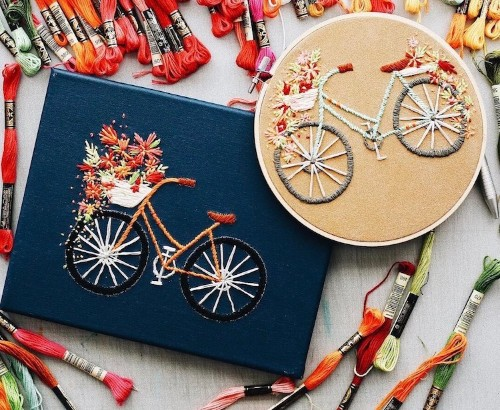Bicycle Embroidery Feature Lovely Baskets Overflowing with Colorful Flowers