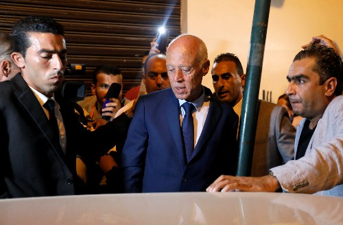 Tunisians pick from varied line-up in unpredictable presidential vote