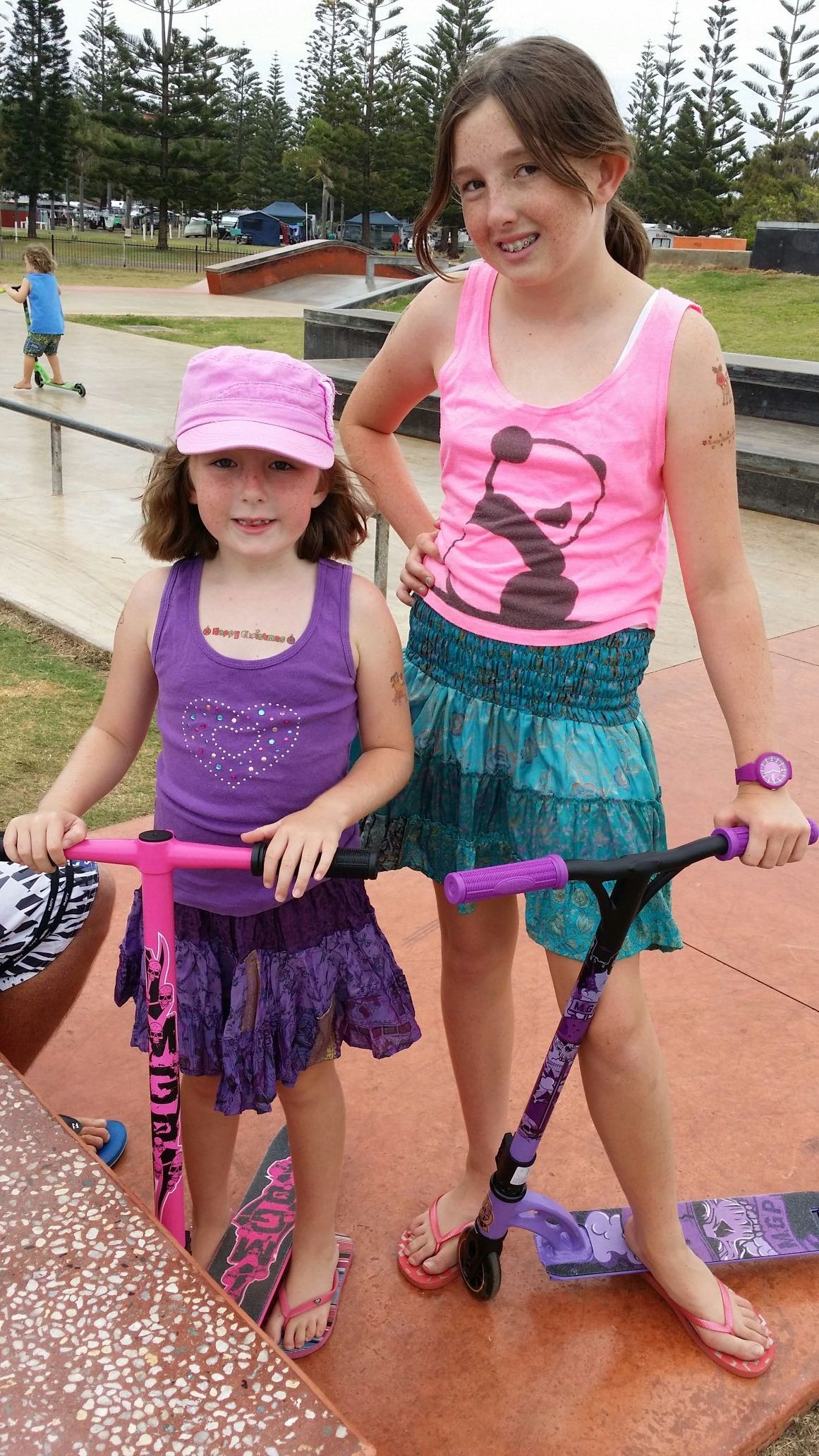 2 beautiful girls at xmas :) new scooters pink n purple :) ♡♡