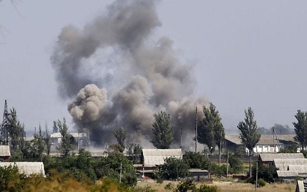 Ukraine crisis: rebels seize key coastal town as they open new front near Russia