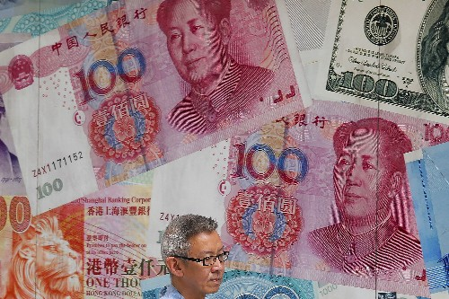 China lets yuan sink, Trump says serious talks to start