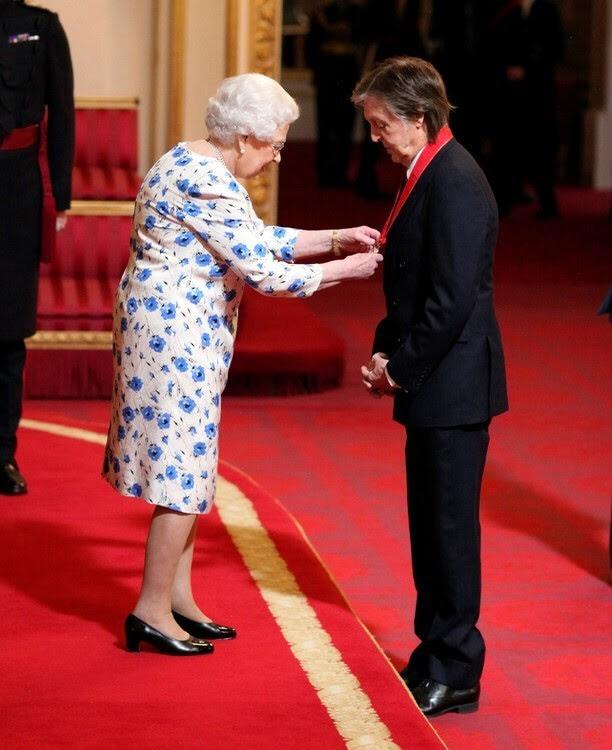 Paul McCartney receiving the insignia