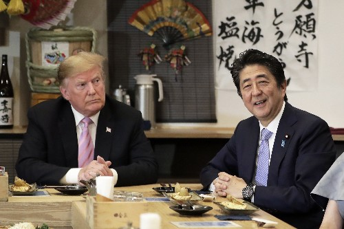 The Latest: Abe drives Trump around golf course near Tokyo
