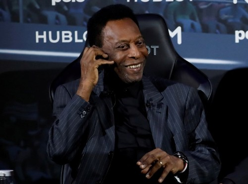 Soccer: Pele back in Brazil, healthy but undergoing tests