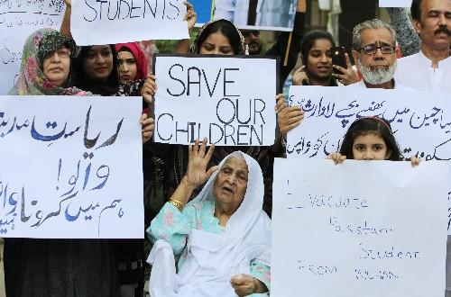 Parents protest as Pakistani students stuck in China under coronavirus lockdown