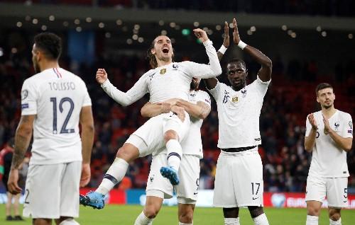 Soccer: France celebrate 2-0 win in Albania's new stadium