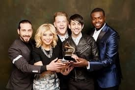 Pentatonix is an American acappella group from Arlington, Texas consisting of five vocalists: Avi Kaplan, Scott Hoying, Kirstin Maldonado, Kevin Olusola, and Mitch Grassi. Their work is mostly in the pop style consists of covers of existing songs sometimes in the form of medleys along with their original material. Their music is defined by their own arrangement style, tight vocal harmonies, extensive vocal riffing, deep and steady vocal basslines, and a diverse range of vocal percussion and beatboxing. Pentatonix formed in 2011 and came to prominence the same year by winning the third season of The Sing-Off on NBC, their victory earning them $200,000 and a recording contract with Sony Music. After being dropped from Epic after The Sing-Off, the group formed their popular YouTube channel and distributed their music through Madison Gate Records, a small independent label owned by Sony Pictures that mainly distributes movie soundtracks. The group also makes effective use of social media to interact with their fan base. Having now eclipsed 10.5 million subscribers and more than 1.54 billion total views, Pentatonix's official YouTube channel is currently the 13th most subscribed music video channel and the 44th most subscribed channel overall, with their most viewed music video being a tribute to Daft Punk that has accumulated over 200 million views. -Reuben Deuna