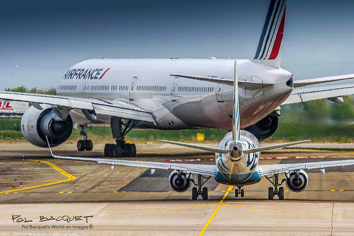 An Air France Boeing 777-300 aligning on Runway for take-off in Paris Roissy CDG Airport