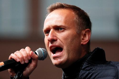 Russian investigators raid Kremlin critic Navalny's offices