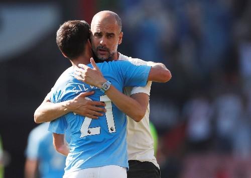 Soccer: 400 the magic number as Guardiola hails Silva, Aguero