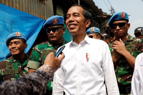 Official count gives President Widodo victory in Indonesian election, opposition claim cheating