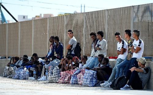 Spain offers ports to stranded migrant boat but chastises Italy