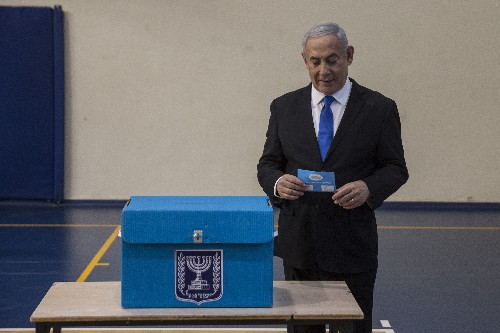 The Latest: Netanyahu challenger: Too soon to call victory