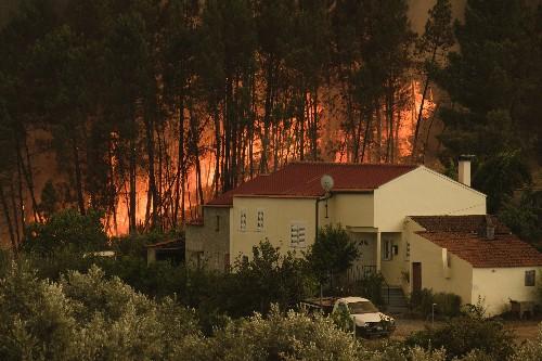 Firefighters battle wildfire in Portugal, 32 people hurt