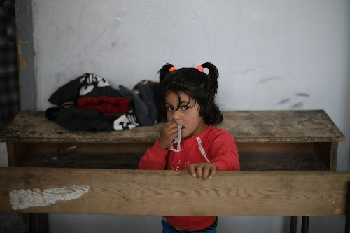 Kurdish families stuck in crowded schools after fleeing north Syria conflict