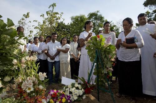 The Latest: Sri Lanka: Bombings retaliation for Christchurch