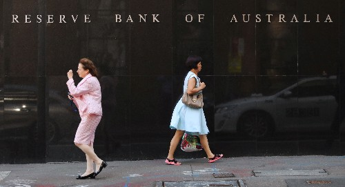 Australia's central bank shifts to clear easing bias, onus on employment to improve